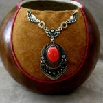 Rust and Red Mahogany-stained gourd with leather inset trimmed in red leather.  Eye-catching red necklace accent.