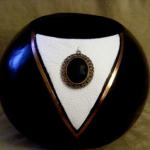 Black Tux Shiny black gourd with white leather 'tux' trimmed in copper leather.  Black medallion.