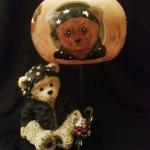 Biker Bear Lamp Gourd shade has woodburned, hand-painted biker bear on front, motorcycle on back.  Paw print cutout designs on sides.