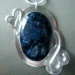 "Heart of Blue - $65  20x28mm Blue Pietersite  Pendant  Sterling Silver backing, hearts and swirls. Measures 1-3/4"" x 2""."