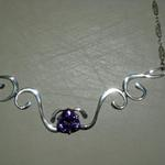 Sweet Lavender - $125 12x12mm amethyst set atop sterling silver curls.