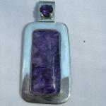 Color Me Purple - $ 75 Rectangle shaped charoite encased in Sterling Silver.  5mm purple Amethyst stone above charoite.