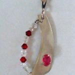 "Ruby - $85 4x6mm Ruby with swarovski crystals on sterling silver with 20"" chain."